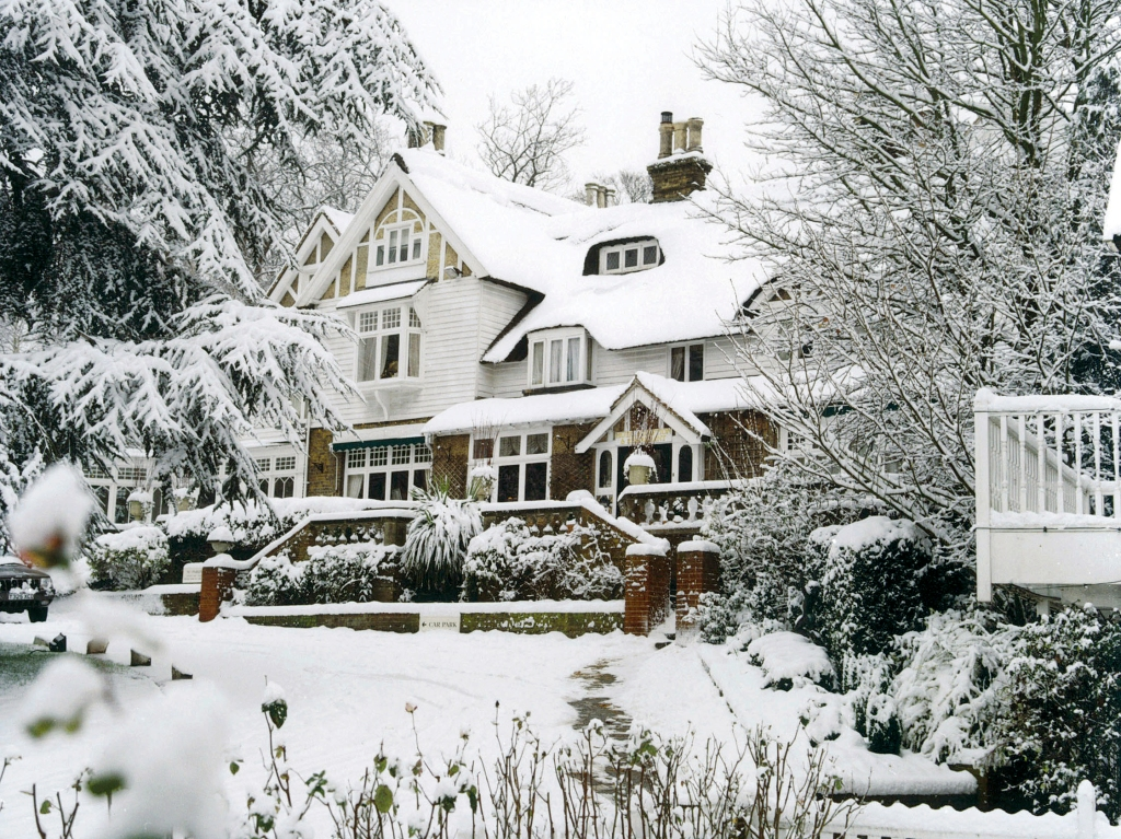 Exterior of Rowhill Grange in the Snow.